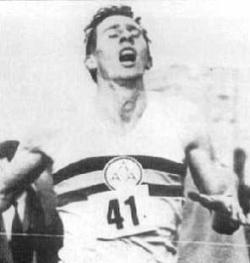 Roger Bannister runs the four minute mile
