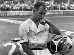 Stirling Moss is first Englishman to win the British Grand Prix